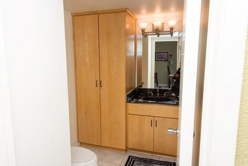 Downstairs Bathroom with Customized Storage Cabinet
