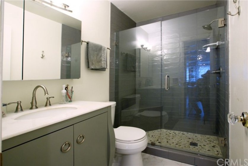 Lovely remodeled master bath, with contemporary walk-in shower