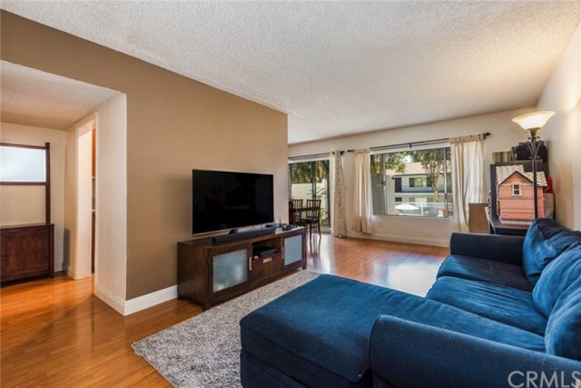 Spacious, bright and comfortable - this is the living room area with large window overlooking pool area