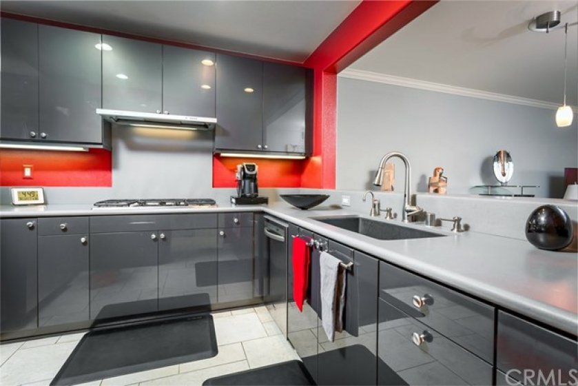 Modern Design Kitchen with Glossy Finish Cabinets and Modern Fan Hood