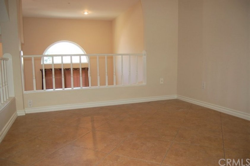 Large dining room with ceiling fan. This overlooks the living room and can also be used as an office area.