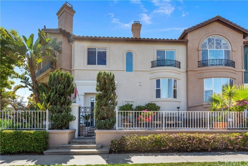 Extraordinary curbside appeal! Private gated Patio