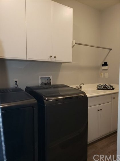 Laundry room all on its own - with plenty of storage, rinse sink is very convenient, washer and dryer come with the home, leads directly to the attached 2-car garage