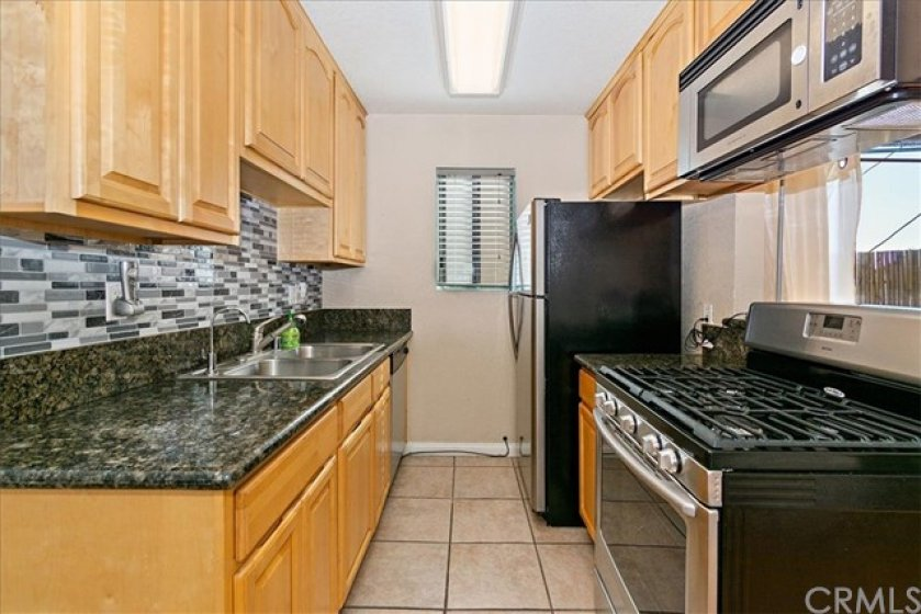 Granite counters and custom tile backsplash. ALL APPLIANCES INCLUDED!