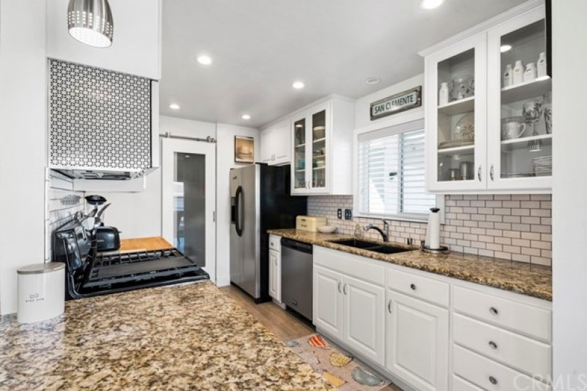 Beautifully updated kitchen with a full pantry.