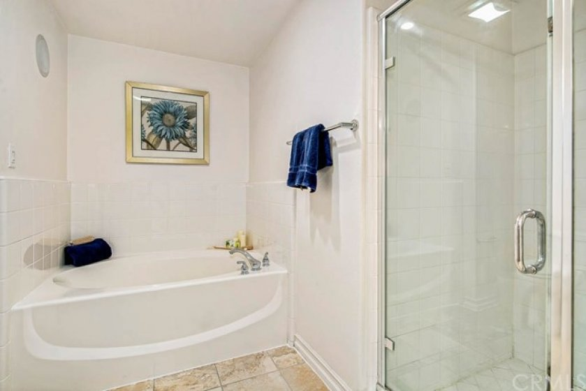 Lovely bath with walk-in shower, separate soaking tub, and built-in speaker to set the mood.