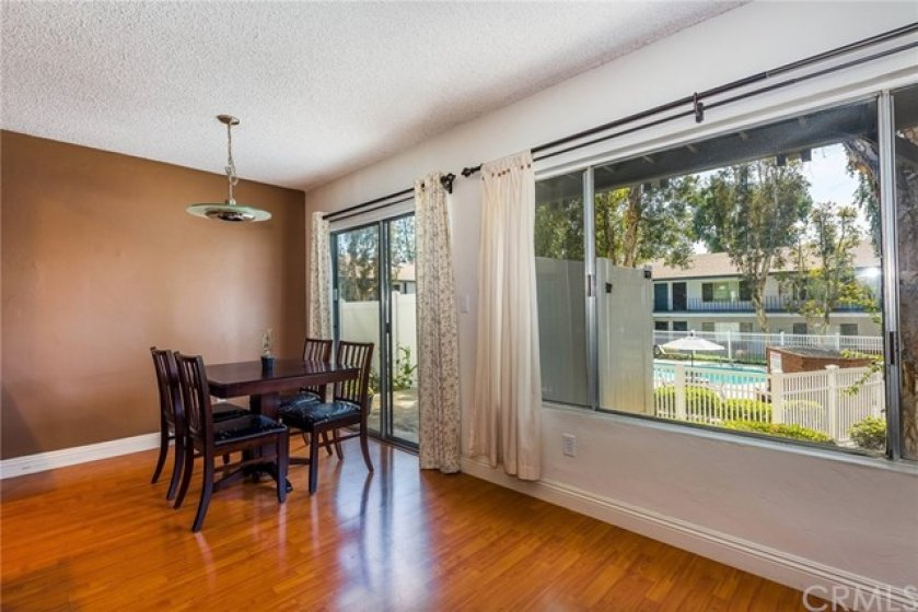 Ample dining room area with access to enclosed patio with exterior access door.