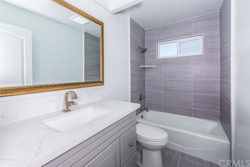 Upgraded Bathroom with all new vanity, fixtures and flooring.