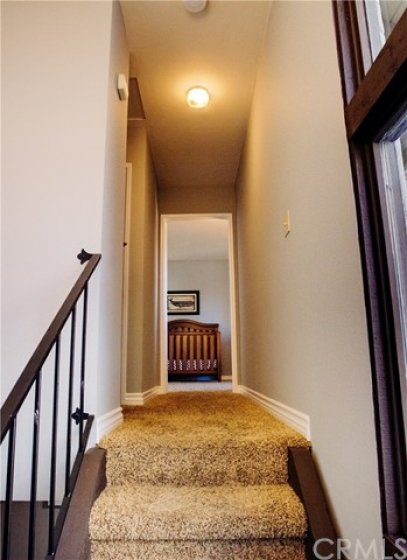 Upstairs hallway leading to second master bedroom.