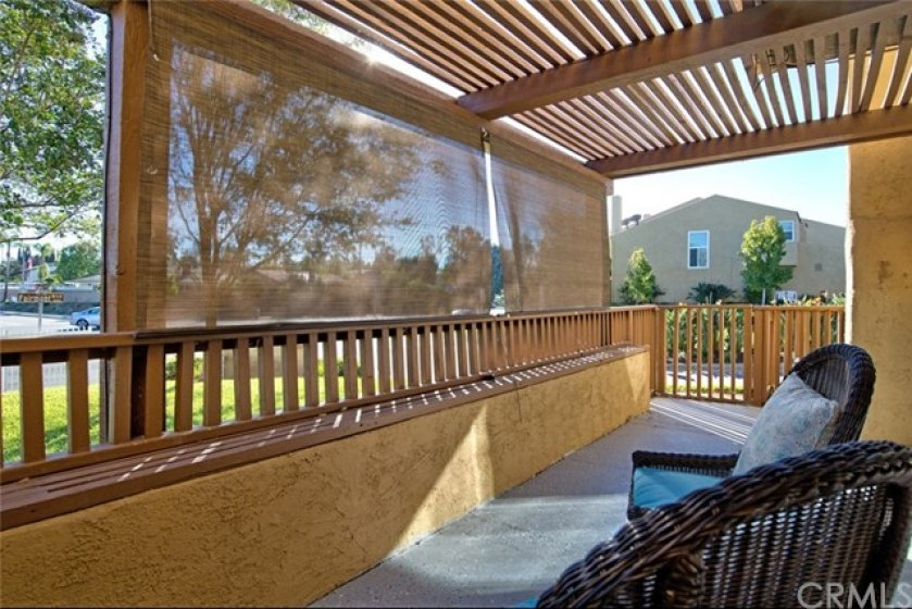 The cover and screens provide shade and add privacy to this spacious patio area.