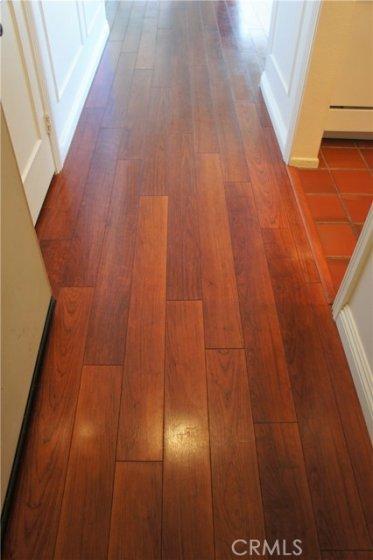 Laminate wood flooring throughout.