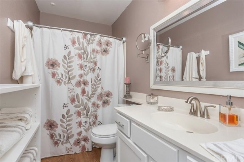 White cupboards in secondary bathroom