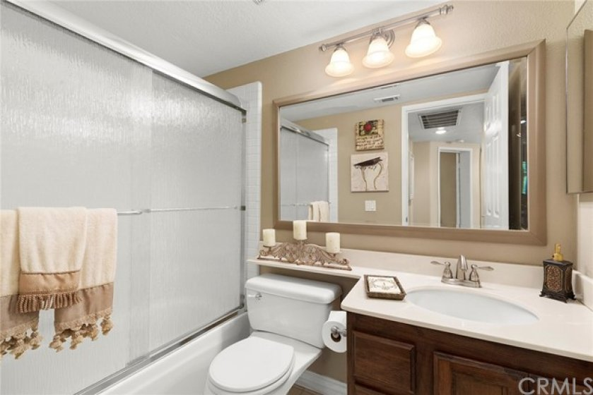 Downstairs bathroom with glass doors- Shower over tub- Tile flooring