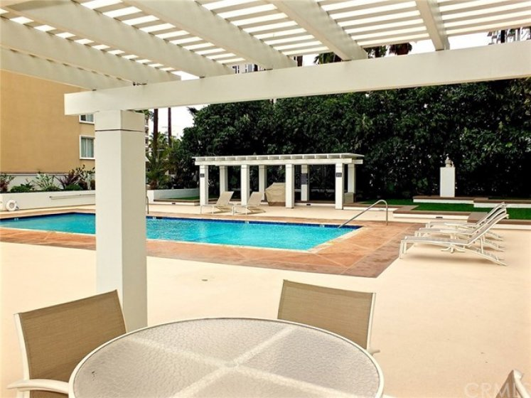 Beautiful Pool Area With BBQ And Tables