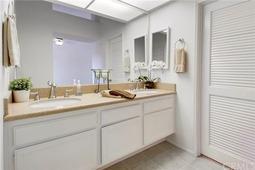 Master Bathroom with twin sinks and Walk-in Closet