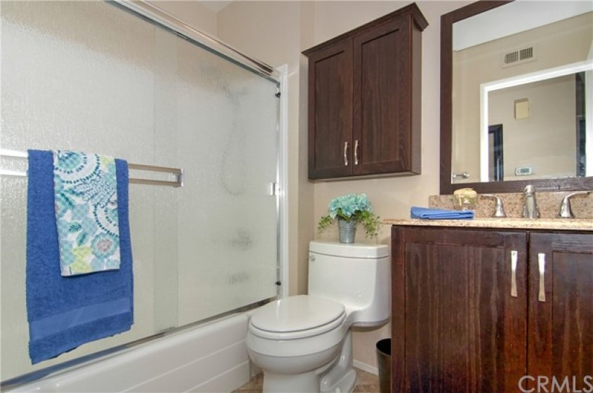 REMODELED HALL BATHROOM WITH TUB AND SHOWER.