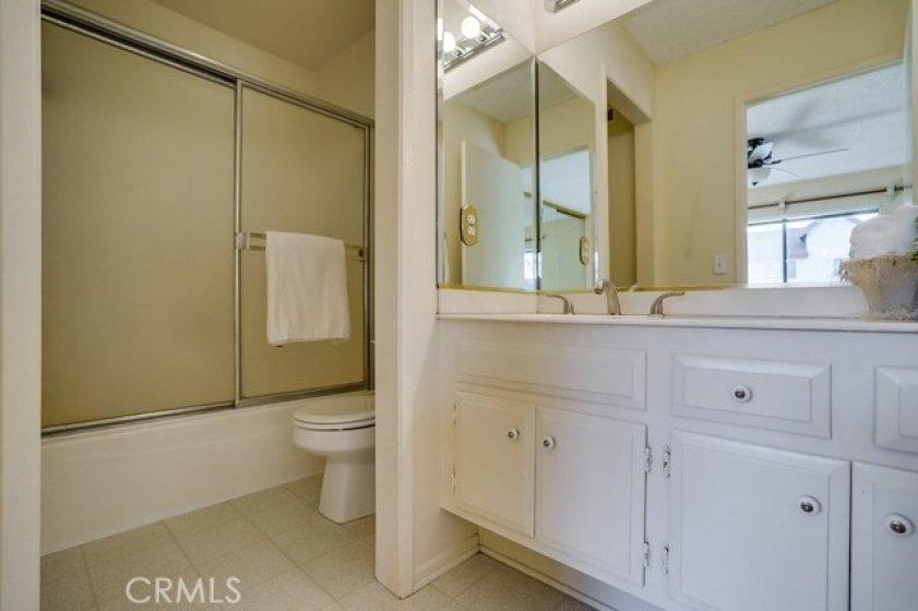 Full bathroom in junior suite is original but clean and functional