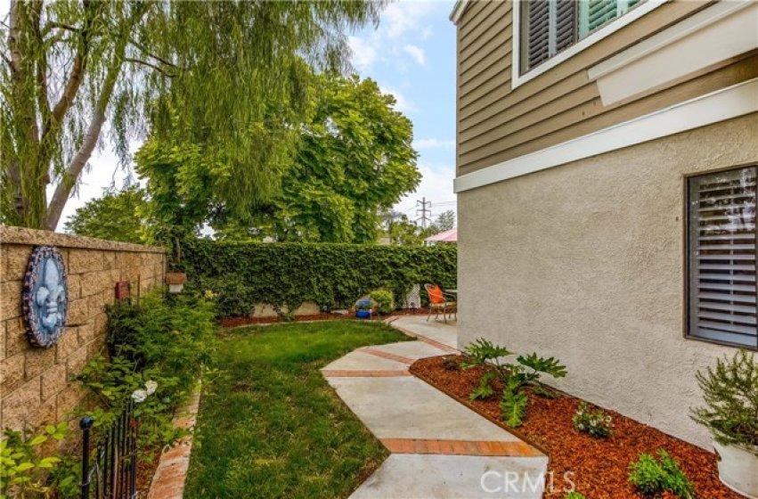 Wrap around side yard .. plenty of space to get your gardening on
