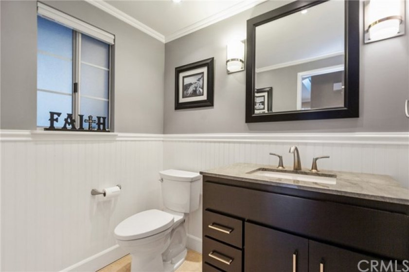 This is downstairs powder room. Charming wainscoting adds character and warmth.