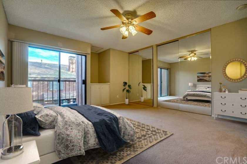 Spacious master retreat with balcony and mirrored wardrobe doors (virtually staged)