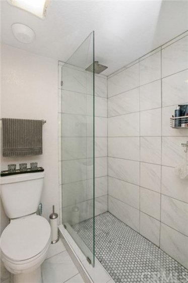 Upgraded walk in shower with glass enclosure