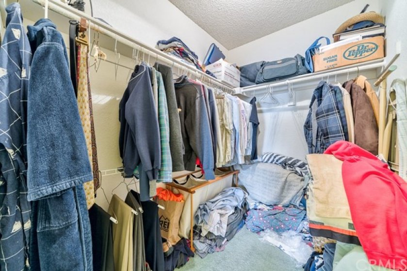 Oh my, what a messy closet. Well, you can see the walk-in closet has quite the space. :-)