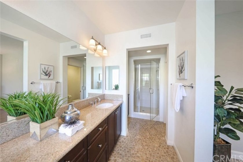 In addition to a spa sized tub, a shower is also located in the dual master suite.