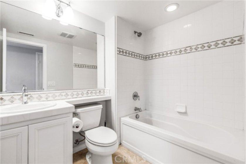 Upstairs hall bathroom with decorator tile