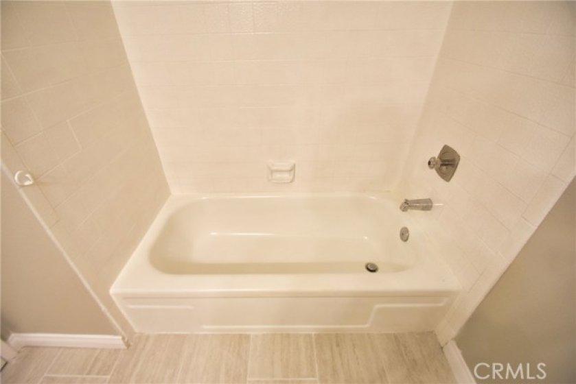 Tub in guest bathroom.