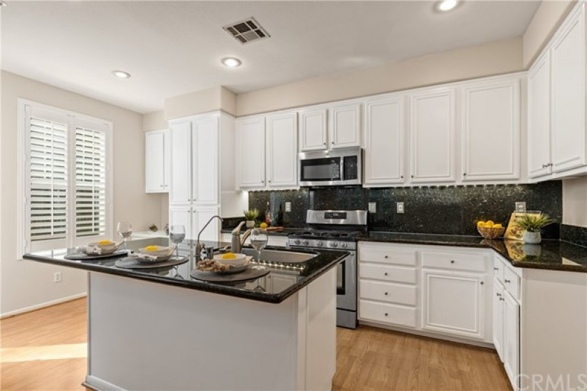 White cabinet with stainless steel appliances