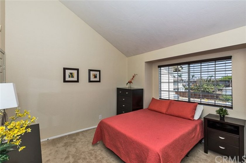 Roomy Master Bedroom with New Paint, New Carpet, Vaulted Ceiling, Walnut Blinds and More.