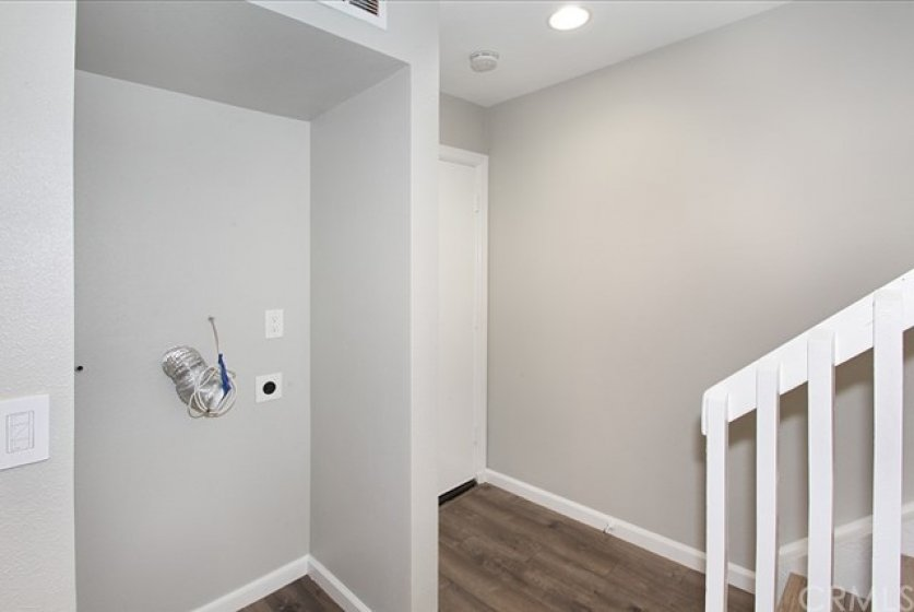 Home has been upgraded to hold a stackable washer and dryer. A brand new washer & dryer have been ordered and will be installed before the end of June. There is also a community laundry.