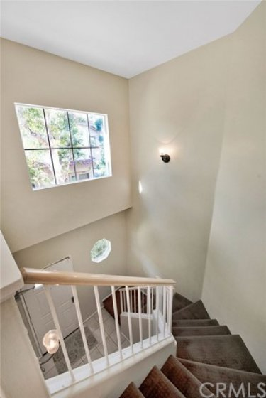 Large window in stairwell adds to brightness of home
