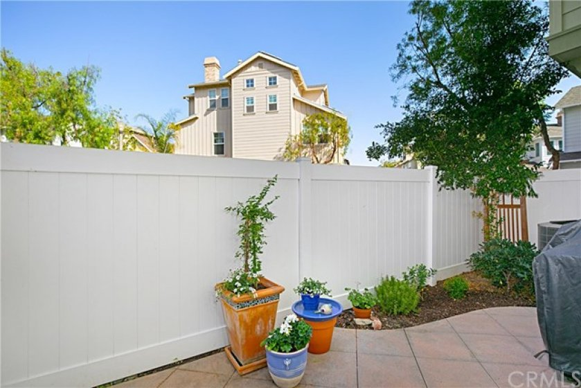 Backyard area offers space for dining al-fresco or making your own private garden.