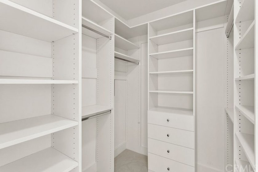 You will find plenty of space in your newly remodeled master closet with orgainers.