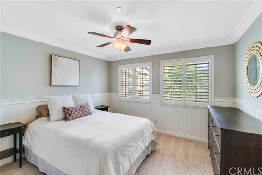 Beautiful wood accents are featured in the back master suite and include beadboard wainscoting, crown molding & upgraded baseboards.