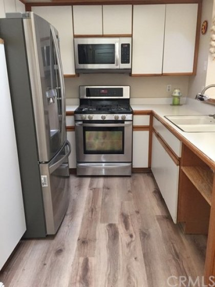 Kitchen with LG and Whirlpool appliances and new premium flooring