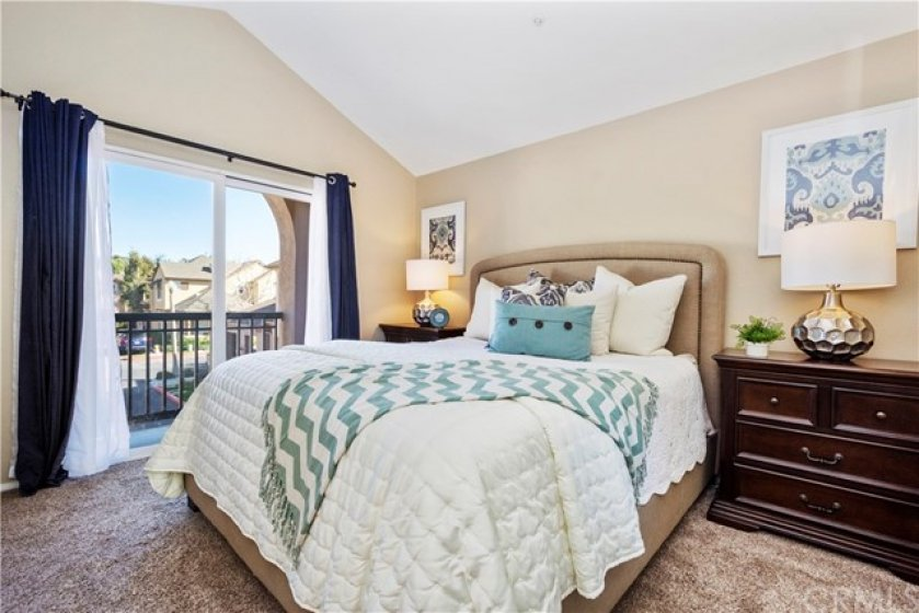 Master Bedroom has vaulted ceilings and private balcony