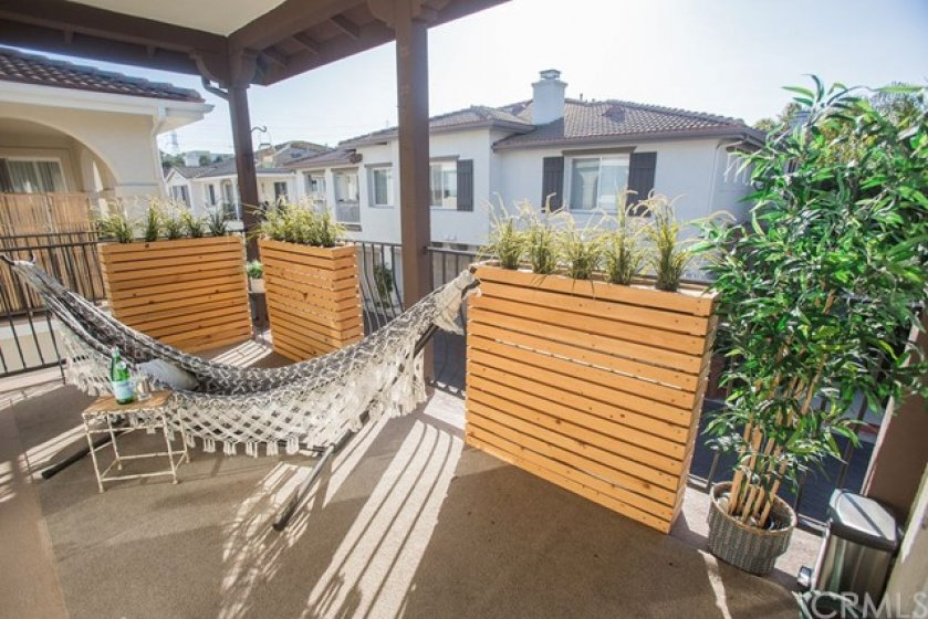 The covered deck is perfect for relaxing.