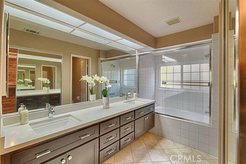 Rich brown wood cabinets, dual under mount sinks, mirrored walk in closet doors.