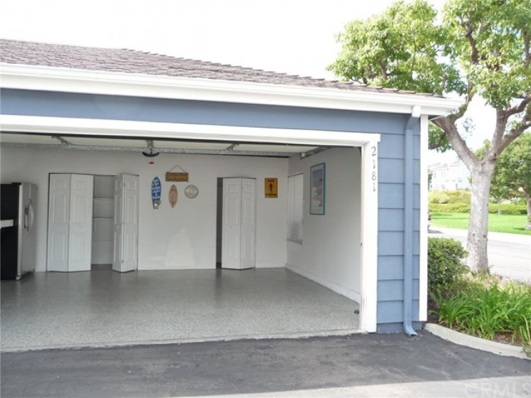 Oversized Two Car Garage with Large Storage Areas and Work Bench