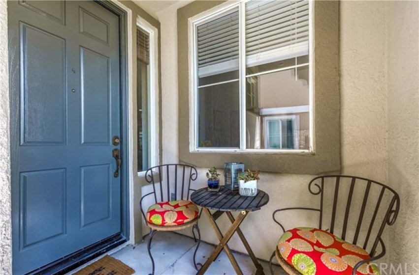 Enjoy your morning coffee on the spacious entry patio area, large enough for a bistro table and chairs!