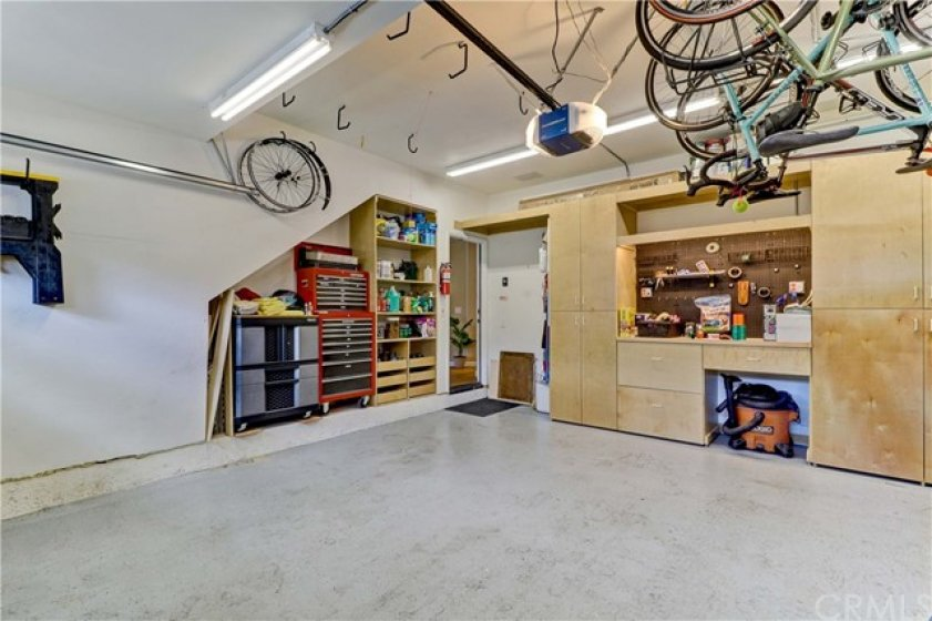 """Garage has Lots of Space for Hanging Mountain Bikes (There are TONS of Trails Close By), Extra Pantry Items, and Yes... Two Full-sized SUVs/Cars! Epoxy Floor; Custom Built Cabinets for Power Tools; Shoe Shelves to Store Dirty Hiking Boots After a Day on the Local Trails 2 Blocks From the Front Door! Lots of """"Daylight"""" Fluorescent Tube Lights to Help With """"Handy Person"""" Projects."""