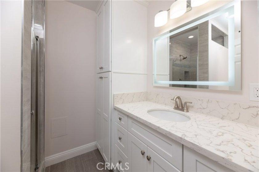 New Master Bath With Tiled Shower, Custom Cabinets, Linen Closet, Quartz Counters, And Custom Lighting
