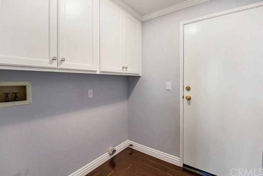 Separate Interior Laundry Room with Door Leading to Attached Two-Car Garage