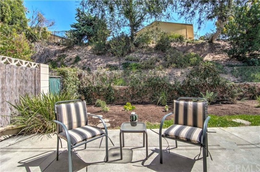 How about the backyard? Yes, I said Backyard, not just a patio slab like many others in this price range. (Hill slopes up to single family home neighborhood.)