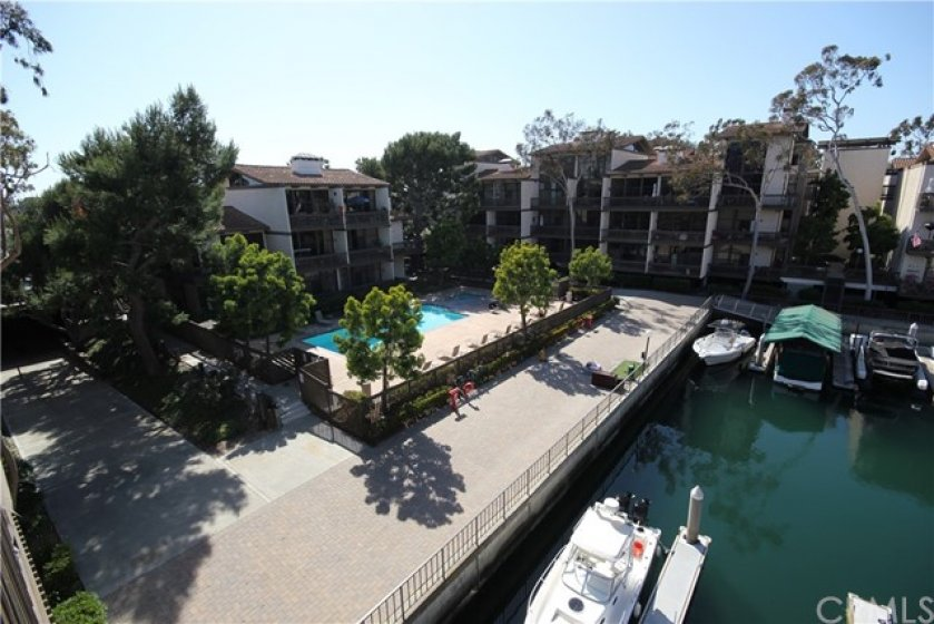 Panoramic view of the Marina and pool area from your private waterfront balcony!