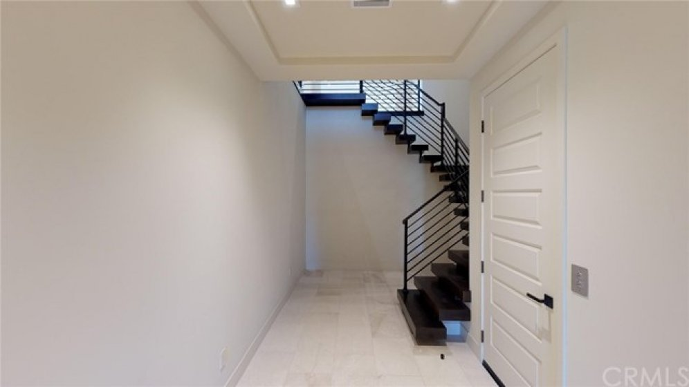 Entry level from garage to the stairs or the elevator.
