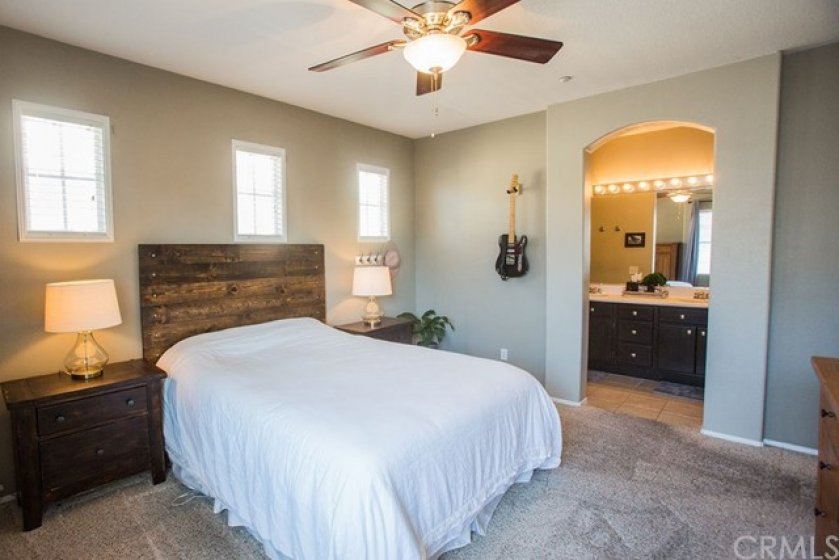 The master bedroom with arched entry into the master bath.
