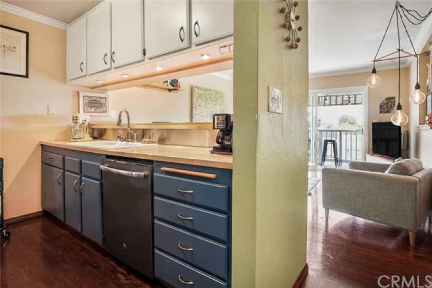Kitchen with beautiful butcher block counters and freshly painted cabinets.
